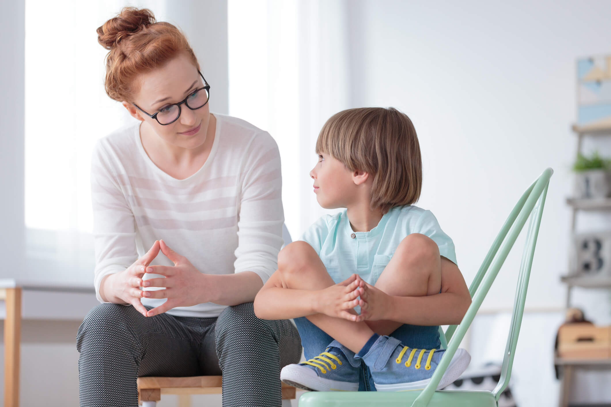 counselor talking with boy